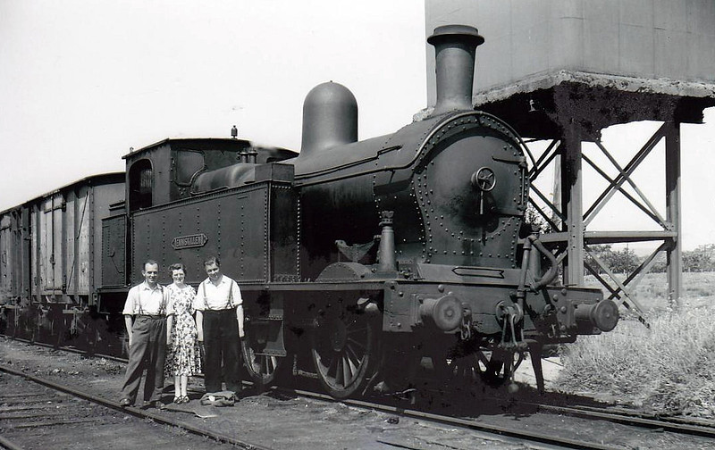 ENNISKILLEN - 'Sir Henry' Class 0-6-4T built 1905 by Beyer Peacock, Works No.4720 - withdrawn 1957 - seen here at Collooney with the station staff.
