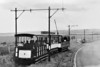 "GIANTS CAUSEWAY, PORTRUSH & BUSH VALLEY TRAMWAY - TRAILER No.6 - A 'toast-rack' trailer with a roof in tow of a similar tramcar and an enclosed trailer - seen here in 1948.<br /> The Giant's Causeway Tramway, operated by the Giant's Causeway, Portrush and Bush Valley Railway & Tramway Company Ltd, was a pioneering 3 foot narrow gauge electric railway operating between Portrush and the Giant's Causeway on the coast of County Antrim. The line, 9.25 miles long, was hailed at its opening as ""the first long electric tramway in the world. The line opened in 1883 with 4 steam trams operating on the Portrush - Bushmills section but in September 1883, a full electric service began, powered at 550vDC from a third rail, power provided hydroelectrically. In 1895, a cyclist was killed when he touched the third rail and so from July 1899 overhead wires were installed. The line was busy until the mid-20's and closed completely in 1949. Rolling stock consisted of up to 6 powered tramcars, some 'toast-rack', some enclosed, and up to 15 non-powered trailers."