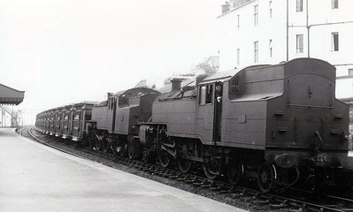 NORTHERN IRELAND RAILWAYS - 56 - Class WT 2-6-4T - built 1950 by British Railways, Derby Works, as UTA No.56 - 1968 to NIR as No.56, fitted with enlarged bunker - withdrawn 1970 - seen here with unidentified sister with normal bunker on spoil train, post 1968.