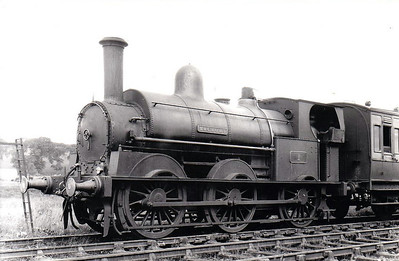 DUNDALK, NEWRY & GREENORE RAILWAY - 1 MACRORY - 0-6-0ST, built 1873 by LNWR Crewe Works - withdrawn 1951 when the railway closed - seen here at Newry in 1933.