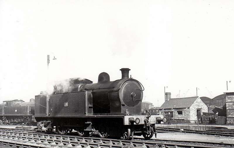 209 - 4-4-2T, built 1925 by Beyer Peacock as Belfast & County Down Railway No.9 - 1948 to UTA as No.209 - 1953 to store - withdrawn 1956 - seen here at Belfast Queens Quay in 1950.