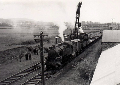 4 - NCC Class WT 2-6-4T - built 1947 at Derby Works - 1948 to UTA - 1968 to NIR - withdrawn 1971 - seen here with steam crane and unknown sister at Ballyclare Junction.