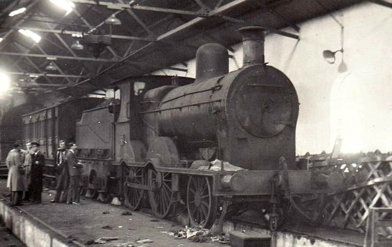 6 - B&CDR 2-4-0, built 1894 by Beyer Peacock - 1943 rebuilt with Belpaire boiler, 1948 to UTA, 1951 placed in store, 1956 withdrawn - seen here in store at Belfast Queens Quay, 06/52.