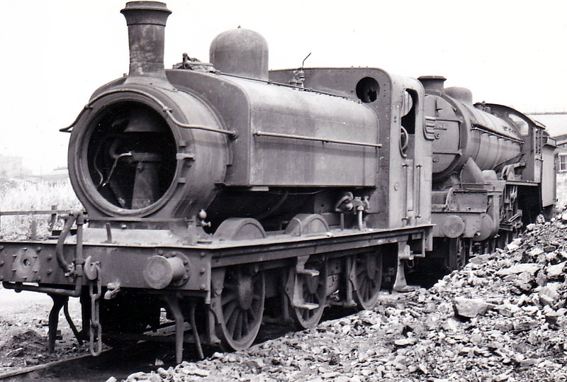 68815 - Ivatt GNR Class J52 0-6-0ST - built 12/1898 by Robert Stephenson & Co. , Works No.2921, as GNR No.1216 - 10/25 to LNER No.4216, 10/46 to LNER No.8815, 11/48 to BR No.68815 - 05/58 withdrawn from 36A Doncaster, where seen on the scrapline, somewhat robbed, with 61605 LINCOLNSHIRE REGIMENT, in July 1958.