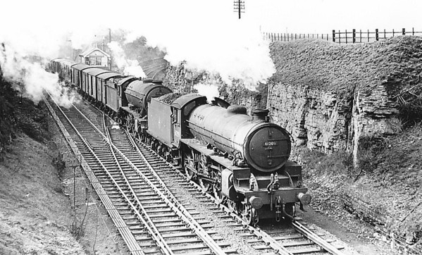 61209 - Thompson LNER/BR Class B1 4-6-0 - built 07/47 by North British Loco. Works as LNER No.1209 - 08/49 to BR No.61209 - 09/62 withdrawn from 38A Colwick - seen here piloting a Class K3 at Kirkby in Ashfield, 06/56.