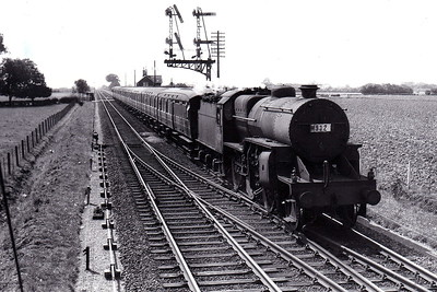42823 - Hughes LMS Class 5F Crab 2-6-0 - built 10/29 by Horwich Works as LMS No.13123 - 08/35 to LMS No.2823, 07/48 to BR No.42823 - 02/64 withdrawn from 21A Saltley - seen here at Firsby Junction bound for Skegness on a summer Saturday train probably from Birmingham. The signals are off for the Skegness line.
