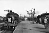 43060 - BR Ivatt Class 4MT 2-6-0 - built 10/50 by Doncaster Works - 12/64 withdrawn from 40E Colwick - seen here taking over the last Birmingham sitting on the other side of the platform at Spalding, 28/02/59. Affixing the headboard seems to be very noteworthy task!