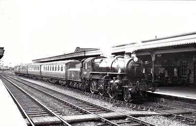 43089 - Ivatt LMS Class 4MT 2-6-0 - built 12/50 by Darlington Works - 11/65 withdrawn from 41J Langwith Junction - seen here at Ely on the 1039 from Liverpool Street in August 1958 - note tablet exchange apparatus.