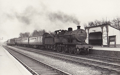 40453 - Johnson LMS Class 2P 4-4-0 - built 06/1894 by Derby Works as MR No.194 - 1907 to MR No.453, 03/50 to BR No.40453 - 09/62 withdrawn from 26F Patricroft - seen here at Luffenham Junction on a Birmingham train, 03/54. Note Stamford/Seaton Junction autotrain to left.