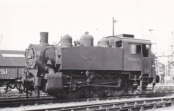 30063 - USA Class 0-6-0T - built 1942 by Vulcan Ironworks as WD No.1244 - 06/47 to SR No.63, 01/51 to BR No.30063 - 05/62 withdrawn from 70I Southampton Docks, where seen on 09/61.