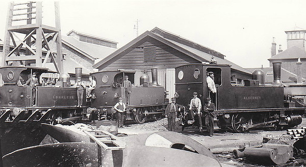 SOUTHAMPTON DOCKS LOCO SHED, August 1903 - The LSWR gained control of the railway system in Southampton Docks in 1892 and provided the docks with a fleet of Adams Class B4 0-4-0T's. Seen here are three of the class:<br /> 85 ALDERNEY (right) - built 10/1891 by Nine Elms Works - BR No.30085 not applied - 01/49 withdrawn from 71A Eastleigh.<br /> 102 GRANVILLE (centre) - built 12/1893 by Nine Elms Works - 12/50 to BR No.30102 - 09/63 withdrawn from 71A Eastleigh - preserved.<br /> 95 HONFLEUR (left) - built 11/1893 by Nine Elms Works - BR No.30095 not applied - 04/49 withdrawn from 72D Plymouth Friary - sold on for industrial use.<br /> Note that the two locos on the left have cutaway cabs. These provided much better visibility for shunting.