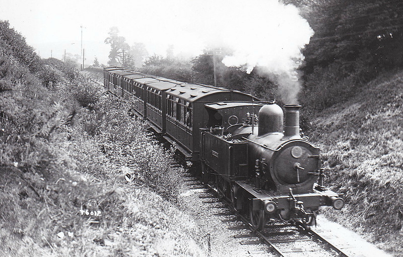 ISLE OF WIGHT RAILWAY - SHANKLIN - IOWR 2-4-0T - built 06/1864 by Beyer Peacock Ltd, Works No.403 - 1923 to SR No.14 SHANKLIN - 11/27 withdrawn - seen here on a Ryde - Ventnor train.