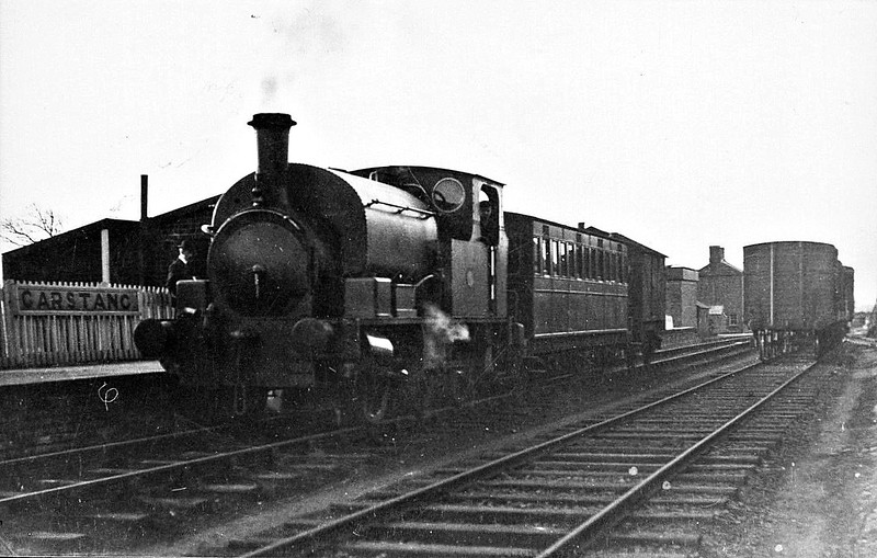 GARSTANG TOWN STATION - One of the line's several Hudswell Clarke 0-6-0ST's, probably HOPE, stands in the rather sumptuous setting of Garstang Town Station with a train for Knott End On Sea.