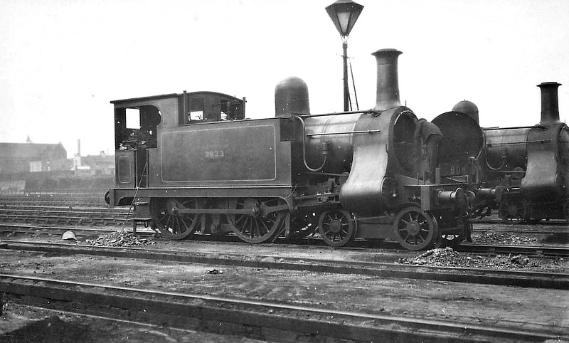 2833 - Price LNWR Class 1 4-4-0T - built 1904 by Bow Works as NLR No.40 - 1922 to LNWR No.2833 - LMS No.6455 not applied - 1926 withdrawn - seen here at Devons Road, 08/25.
