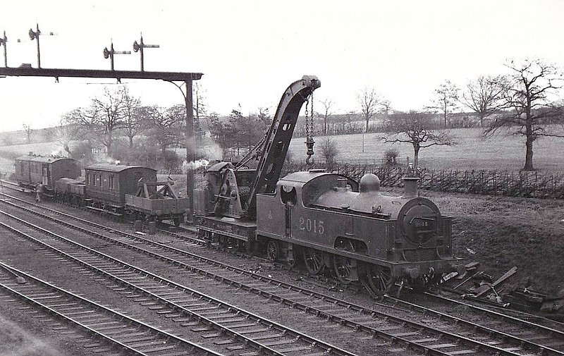2015 - Deeley MR Class 2000 3P 0-6-4T - built 04/07 by Derby Works - withdrawn 03/36 from 21A Saltley - seen here derailed at Halesowen Junction, showing little evidence of any damage, 02/22 (see 'Off The Straight & Narrow' for more details). This loco derailed again at Swinderby, 06/28.