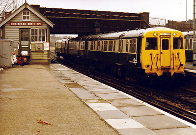 WIRRAL RAILWAY - BIRKENHEAD NORTH - M28660M arrives with a train for Liverpool in November 1983.