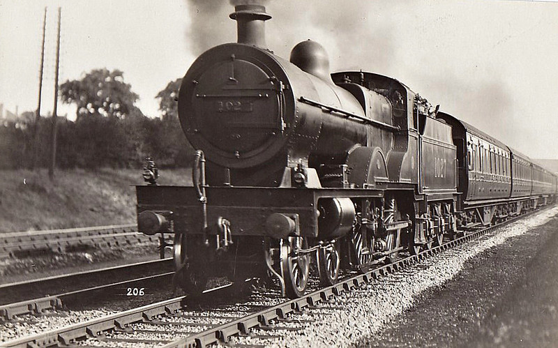 MR - 1027 - Johnson MR Class 4P Compound 4-4-0 - built 06/06 by Derby Works - 1948 to BR No.41027 - 09/48 withdrawn from 22B Gloucester Barnwood - seen here at Mill Hillon the Down Heysham Boat Train - note that the '7' has fallen off the smokebox numberplate.