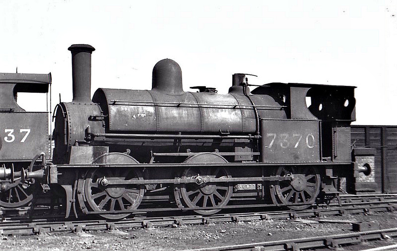 LNWR - 7370 - Ramsbottom/Webb LNWR Class Special Tank 1F 0-6-0ST - built 1877 by Crewe Works as LNWR No.967 - 1898 to Duplicate List as No.3315, 1923 to LMS No.7370, 1932 to LMS No.27370 - 1940 withdrawn - seen here at Crewe Works, 08/35.