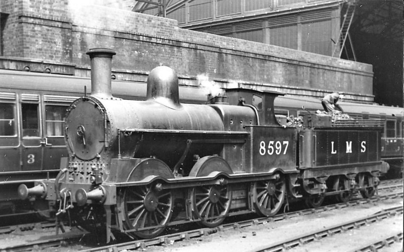 LNWR - 8597 - Webb LNWR Class 2F 'Coal Engine' 0-6-0 - built 04/01 by Crewe Works as LNWR No.2206 - 1923 to LMS No.8597, 1934 to LMS No.28597 -  01/48 withdrawn from Walsall Ryecroft MPD - seen here at Birmingham New Street, 05/38.