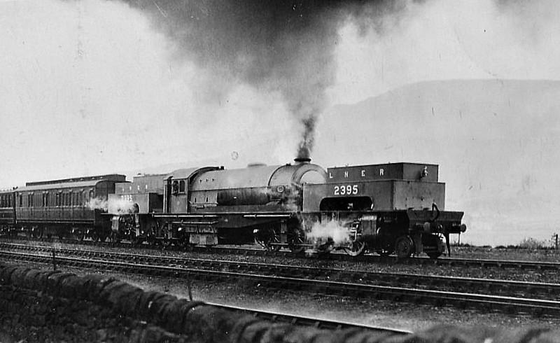 Class U1 - 2395 - Gresley LNER 2-8-0+0-8-2T - built 06/25 by Beyer Peacock Ltd. - 03/46 to LNER No.9999, 11/48 to BR No.69999 - 12/55 withdrawn from 39A Gorton - built to bank trains up the Worsborough Incline - most powerful British steam locomotive ever built seen here when new, on test I think, with the LNER Dynamometer Car behind.