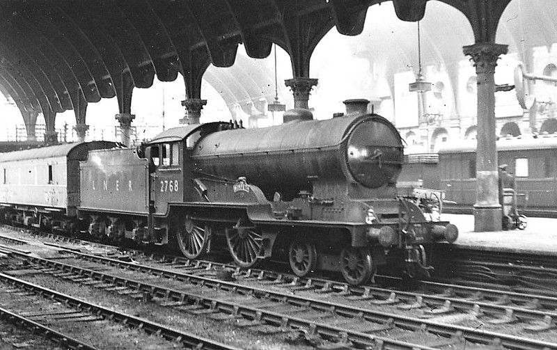 Class D49 - 2768 THE MORPETH - Gresley LNER Hunt Class 4-4-0 - built 12/34 by Darlington Works as LNER No.365 - 1942 rebuilt by Thompson with 2 Inside Cylinders - 11/46 to LNER No.2768, 08/48 to BR No.62768 - 11/52 withdrawn from 50D Starbeck after being in collision at Dragon Junction - seen here at York, 07/47.
