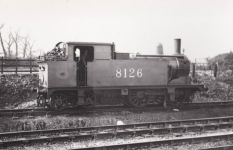 Class G6 - 8126 - Holden GER 0-4-4T - built 05/00 by Stratford Works as GER No.1126 - 1924 to LNER No.8126 - 12/33 withdrawn from Stratford MPD - seen here at Chingford, 04/26 - note condensing gear.