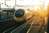 Class 390 018 catches the morning sun as it departs Nuneaton on the 0915 to Manchester, 02/01/04.