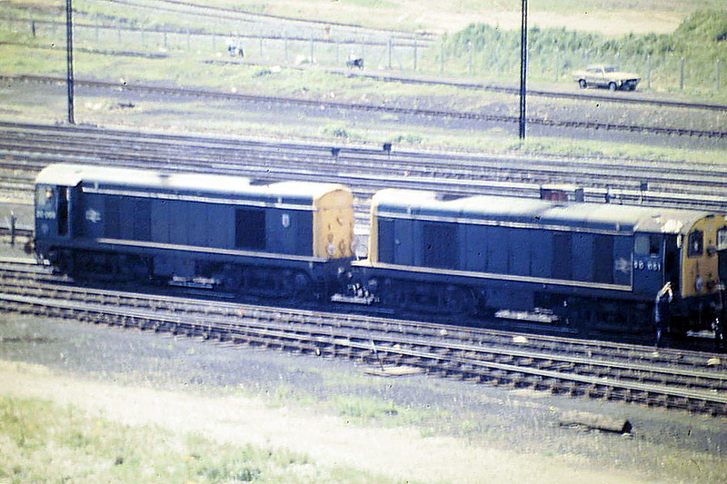 20069 and 20051 have just brought in a rake of loaded HTV's to Toton Up Yard and will now collect a rake of empties from the Down Yard, 05/85. 20069 was withdrawn in May 1991 and preserved whilst 20051 was withdrawn in February 1991.