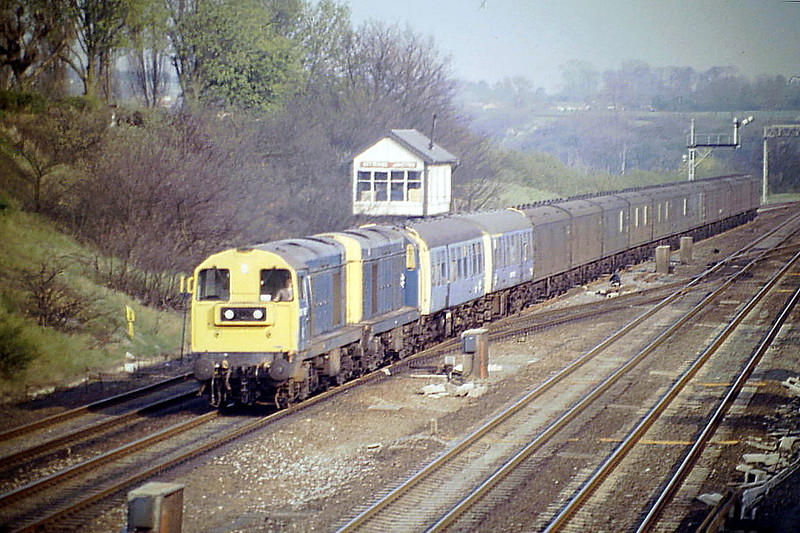 20130 and 20180 are northbound at Glendon Junction with a rake of scrap parcels vans, 23/04/87. The first two vehicles are Departmental DMU's 977051 and 977114, also for scrap. 20130 was withdrawn in October 1990 and 20180 in February 1989.