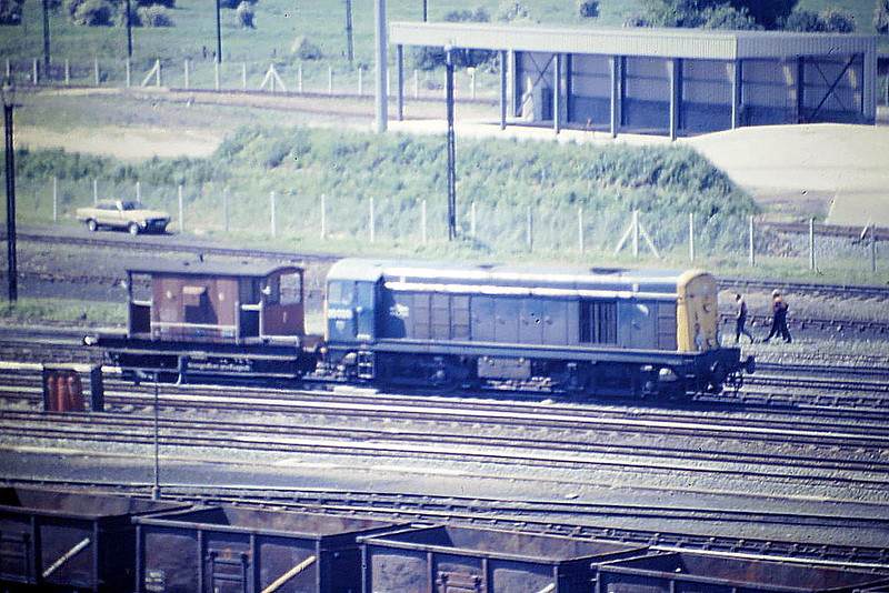 20020 leaves the Down Yard at Toton Engine and Brake, 05/85. Single Class 20's were very unusual in England. Note the Motherwell 'Leaping Salmon' Depot Emblem. 20020 was withdrawn in October 1990 and is preserved at the Bo'ness & Kinneil Railway.
