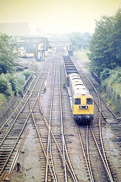 20136 and 20180 pass Melton Mowbray Station on 6M09 Colchester Hythe - Toton Coal Empties, 11/08/87.