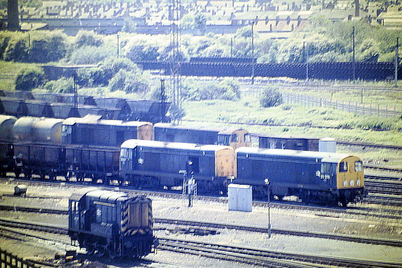 20078 and 20047 head a rake of empty HTV's whilst, behind them, 20016 and 20001 have brought in a rake of tanks, 08899 in the foreground, 05/85.