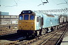 25190 passes through Crewe Station with a Down ballast train, 30/08/84. This loco was withdrawn in January 1987.