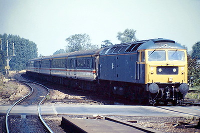 47121 pulls into Ely Station with a Norwich - Liverpool Street diversion, 08/08/88. 47121 was built by Brush Falcon Works in 1964 as D1710 and renumbered in February 1974. It was withdrawn in December 1994 and scrapped in April 1997.