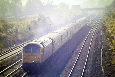 47543 approaches Little Bytham with the Down 'European' to Manchester via Nottingham, 07/10/86. 47543 was built by Crewe Works in 1964 as D1588 and was renumbered and ETHed in December 1974.  It was withdrawn and scrapped in April 1998.