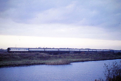 47545 heads for Ely on the 1613 Kings Lynn - Liverpool Street near Ely North Junction, 30/10/86. 47545 was built by Crewe Works in 1965 as D1646 and was renumbered and ETHed in November 1974. In September 1988 it became a dedicated engineering loco was was numbered 97545, being renumbered 47972 in August 1989.  It was withdrawn in December 1998 and went to Fragonset Railways in December 2001 and was scrapped in March 2010.