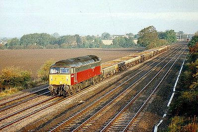 47574 BEN GIMBERT GC heads south at Cossington with a rake of spoil empties, 09/10/96.March is justly proud of Ben Gimbert and Jim Nightall and their role in the Soham Bomb Disaster of June 2nd, 1944. 47574 was built by Brush Falcon Works in 1964 as D1769 and was renumbered to 47174 in February 1974. It was ETHed and renumbered to 47573 in February 1981. It was withdrawn in November 2002 and scrapped in May 2005.
