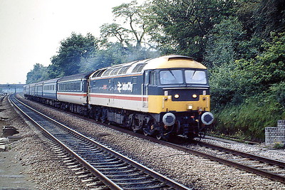 47515 NIGHT MAIL passes West Ealing on a Down Passenger service, 02/06/88, probably to Oxford. 47515 was built by Brush Falcon Works in 1964 as D1961 and was renumbered and ETHed in March 1974. In March 1994 it was fitted for multiple working and became 47769. It was withdrawn in April 2001 and scrapped in May 2006.