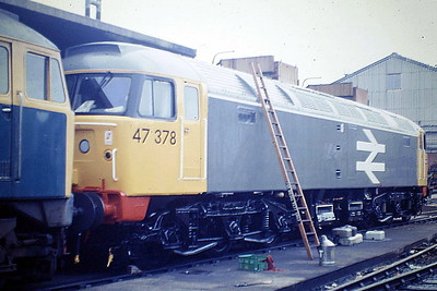 47378 receives finishing touches to its new coat of Railfreight Grey, all the rage in 1985. Note the large cab numerals. Crewe Works, 21/09/85. 47378 was built by Brush Falcon Works in 1965 as D1897 and was renumbered in March 1974. In July 1994 it was renumbered to 47386, reverting to 47378 in September 1995. It was withdrawn and scrapped in September 1998.