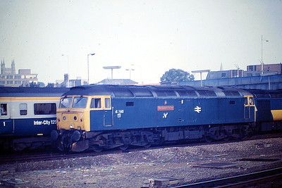47541 THE QUEEN MOTHER, replete with Highland Rail emblem, runs light engine through Peterborough Station to Depot, 26/07/85. 47541 was built by Brush Falcon Works in 1964 as D1755 and was renumbered and ETHed in November 1974. In January 1994 it was fitted for multiple working and became 47773. It was withdrawn in March 2004 and is preserved by Vintage Trains at Tyseley.