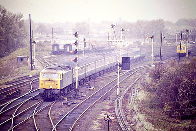 47596 ALDEBURGH FESTIVAL passes Ely Dock Junction on the 1141 Kings Lynn - Liverpool Street, 30/10/86. Note withdrawn DMU stock in sidings bound for the flame tunnel at Snailwell. 47596 was built by Brush Falcon Works in 1966 as D1933 and was renumbered to 47255 in February 1974. It was ETHed and renumbered to 47596 in September 1983. It was withdrawn in November 2002 and is now preserved at the Mid Norfolk Railway