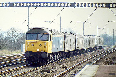 47569 is on the Down Main with a northbound mail train at Huntingdon, 31/03/89. 47569 was built by Crewe Works in 1964 as D1629 and was renumbered to 47047 in February 1974. In January 1981 it was ETHed and renumbered to 47569. In January 1994 it was fitted for multiple working and became 47727. It was withdrawn in February 2004 and in September 2007 it was sold to Colas Rail, who sold it to GBRF in August 2018 where it currently operational.