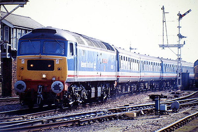 47579 JAMES NIGHTALL GC slows for its Ely stop on a Liverpool Street - Kings Lynn service, 08/08/88. March is justly proud of the two heroes of the Soham disaster of June 2nd, 1944. 47579 was built by Brush Falcon Works in 1964 as D1778 and was renumbered to 47183 in February 1974. It was ETHed and renumbered to 47579 in March 1981. In December 1995 it was fitted for multiple working and became 47793. It was withdrawn in March 2004 and preserved at the Mangapps Railway Museum.