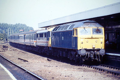 47256 is piloting 86227 into Ely Station on a Norwich - Liverpool Street train, 08/08/88. For some reason, the GE mainline was blocked, at Diss I think, so all Norwich trains were running electric to Cambridge and then dragged to Norwich. 47256 was built by Brush Falcon Works in 1966 as D1934 and renumbered in February 1974. It was withdrawn in September 1998 and scrapped in February 2002.