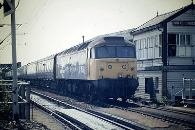 47453 passes Mitre Bridge Junction Box on the Brighton - Manchester, 06/87. 47453 was built by Crewe Works in 1964 as D1560 and was renumbered and ETHed in February 1974. It was withdrawn in March 1994 and scrapped in June 1997.