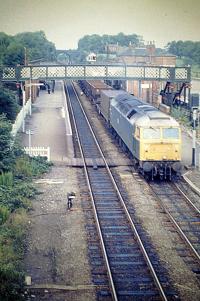 47052 draws away from Melton Mowbray with the Leicester - Corby pick-up freight, 11/08/87. 47052 was built  by Crewe Works in 1964 as D1634 and renumbered in March 1974. In June 1995 it joined the Freightliner fleet. It was withdrawn in January 2001 and scrapped in May 2003..