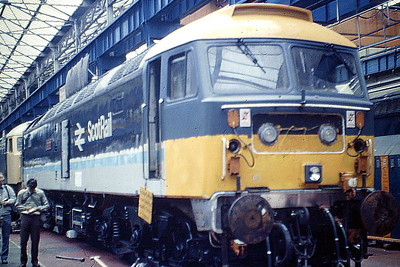 47702 SAINT CUTHBERT is inside Crewe Works undergoing overhaul, 21/09/85. 47702 was built by Brush Works in 1966 as D1947 and ETHed and renumbered to 47504 in March 1974. In March 1979 it was converted to push/pull operation for Glasgow - Edinburgh services and renumbered to 47702. It was withdrawn in May 2000 and scrapped in January 2005.