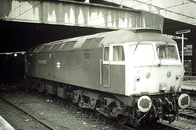 47535 UNIVERSITY OF LEICESTER, having come off a northbound cross country service, now waits in a centre road at Birmingham New Street for an incoming southbound train, 20/02/85. 47535 was built by Crewe Works in 1965 as D1649 and was ETHed and renumbered in April 1974. In May 1983 whilst approaching Luton Station with the 0640 Cricklewood-Luton ecs, 47535 suffered a brake failure which caused it to smash into the rear of the 0605 St Pancras-Bedford DMU. 47535 suffered significant damage, especially to the No.1 end cab. The BR number crunchers calculated that repairing 47535 was a cheaper option than having to ETH another Class 47 so repairs were authorised. It was withdrawn in February 1999 and scrapped in April 2004.