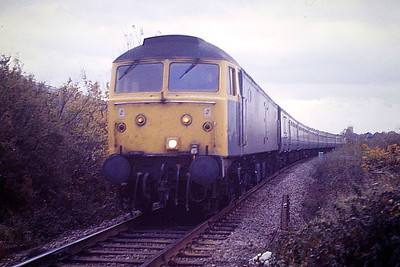 47434 passes Barway Drove on the Down 'European', 30/10/86. 47434 was built by Brush Falcon Works in 1963 as D1549 and was renumbered in June 1974. It was withdrawn in February 1991 and scrapped in November 1993..
