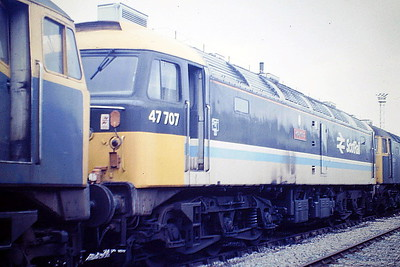 47707 HOLYROOD, in ScotRail Inter City livery, is at Crewe Works for attention after the Falkirk fire, 21/09/85. Note the scorch marks on the body side. 47707 was built by Brush Works in 1966 as D1949 and ETHed and renumbered to 47506 in January 1974. In May 1979 it was converted to push/pull operation for Glasgow - Edinburgh services and renumbered to 47707. In July 1984 the 1730 Edinburgh to Glasgow service hit a cow standing on the track on a bend between Polmont and Falkirk. The train consist was eight coaches pushed by 47707 with a driving trailer leading. Although the driver was able to shut off the engine and apply full brake power the driving cab struck the cow so hard that it was lifted off the track. With the 47/7 still pushing from the rear of the train the leading coaches 'jack-knifed' throwing the passengers around inside, some were even hurled through the windows. In terms of the number of fatalities and injuries this accident ranks amongst the worst in recent times - 13 passengers lost their lives and a further 17 (including the driver) seriously injured. In the wake of this accident fears were raised regarding the safety of 'push-pull' type operations with a relatively light-weight DVT leading. 47707, although derailed, was not significantly damaged. In August 1985 47 707 caught fire at Falkirk High whilst pushing an Edinburgh-Glasgow train  with 47707 pushing, when the train stopped at Falkirk High, a scheduled stop, but after sitting there for about 10 minutes during which time 47707 caught fire. It was subsequently repaired. It was withdrawn in April 2001 and then leased to Fragonset Railways in December 2001, who placed it into store. It then went to Nemesis Rail in August 2007 and was scrapped in February 2010.